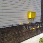 Газовое ДРП на фасаде дома